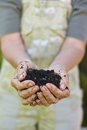 Old woman with a handful of compost Royalty Free Stock Photo