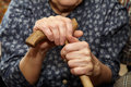 Old woman hands with cane Royalty Free Stock Photo