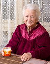 Old woman healthy holding a glass milk Royalty Free Stock Photos