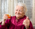 Old woman healthy holding a glass milk Royalty Free Stock Photo