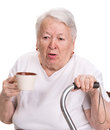 Old woman holding coffee or tea cup over white background Royalty Free Stock Image
