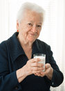 Old woman holding a glass milk healthy Stock Photo