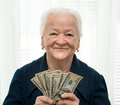 Old woman holding money in hands portrait of Royalty Free Stock Image