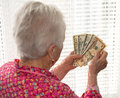 Old woman holding money in hands portrait of Stock Photography
