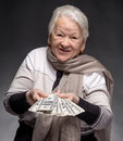 Old woman holding money in hands