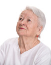 Old woman looking up on a white background Royalty Free Stock Images
