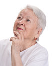 Old woman looking up on a white background Royalty Free Stock Photos