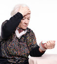 The old woman measures arterial pressure Royalty Free Stock Photo