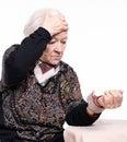 The old woman measures arterial pressure
