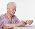 Old woman measures arterial pressure