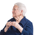 Old woman with painful fingers on a white background Royalty Free Stock Photography