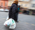 Old woman with plastic bags intentional motion blur Royalty Free Stock Image