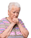 Old woman praying on a white background Stock Photography