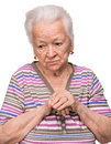Old woman praying on a white background Royalty Free Stock Image