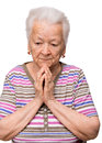 Old woman praying on a white background Royalty Free Stock Photos