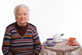 Old woman preparing for  breakfast Royalty Free Stock Photo