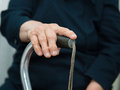 Old woman s hands on a cane Royalty Free Stock Photography