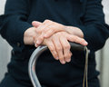 Old woman s hands on a cane Royalty Free Stock Photos