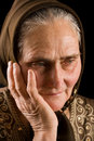 Old woman in sadness Royalty Free Stock Image