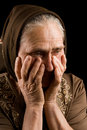 Old woman in sadness Royalty Free Stock Photography