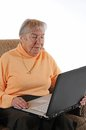 Old woman senior with a laptop Stock Photos