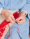 Old woman sews Royalty Free Stock Photography