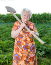 Old woman with a shovel in the garden Royalty Free Stock Photo