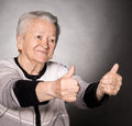 Old woman showing ok sign 库存照片