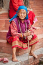 Old woman sit in the retirement home kathmandu nepal founded by mother teresa rajrajeshwari temple near pashupatinath temple Stock Photos