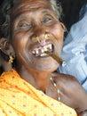 Old woman smokes a cheroot Stock Image