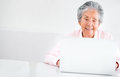 Old woman using a computer portrait of an Royalty Free Stock Photography
