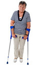 Old woman walking on crutches senior with isolated white Royalty Free Stock Photos