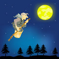 Old woman witch with broom flies on night sky Stock Photo