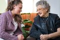 Old woman women with her home caregiver Stock Images