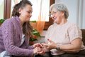 Old woman women with her home caregiver Stock Photos