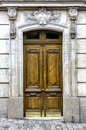 Old wood arch entry door wooden paris france Royalty Free Stock Photos