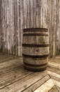 Old wood barrel on a wooden gallery and a wooden house Royalty Free Stock Photo