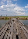 Old wood bridge landscape of with field and sky in the background Stock Photography