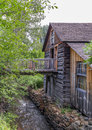 Old wood building on small river bank photo of Royalty Free Stock Photos