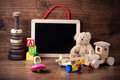 Old wood children toys with teddy bear Royalty Free Stock Photo