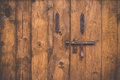 Old wood door with bolt Royalty Free Stock Photo