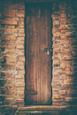 Old wood door and brick wall Royalty Free Stock Photo