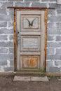 Old wood door in bricks wall Royalty Free Stock Photo