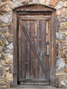 Old wood door in stone wall Royalty Free Stock Photos