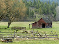 Old wood fence and barn a small weathered by a small footbridge in a field near coeur d alene idaho Stock Photography