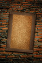 Old wood frame on brick wall Royalty Free Stock Photo