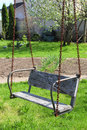 Old wood swing in the garden in spring Royalty Free Stock Photography