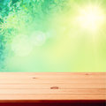 Old wood texture floor surface closeup empty wooden deck table with foliage bokeh background ready for product display montage Stock Photography