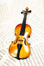 Old wood violin lying  musical notes Stock Photos