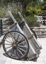 Old wood wheel barrow an western showing signs of wear and the passing of time Royalty Free Stock Photography